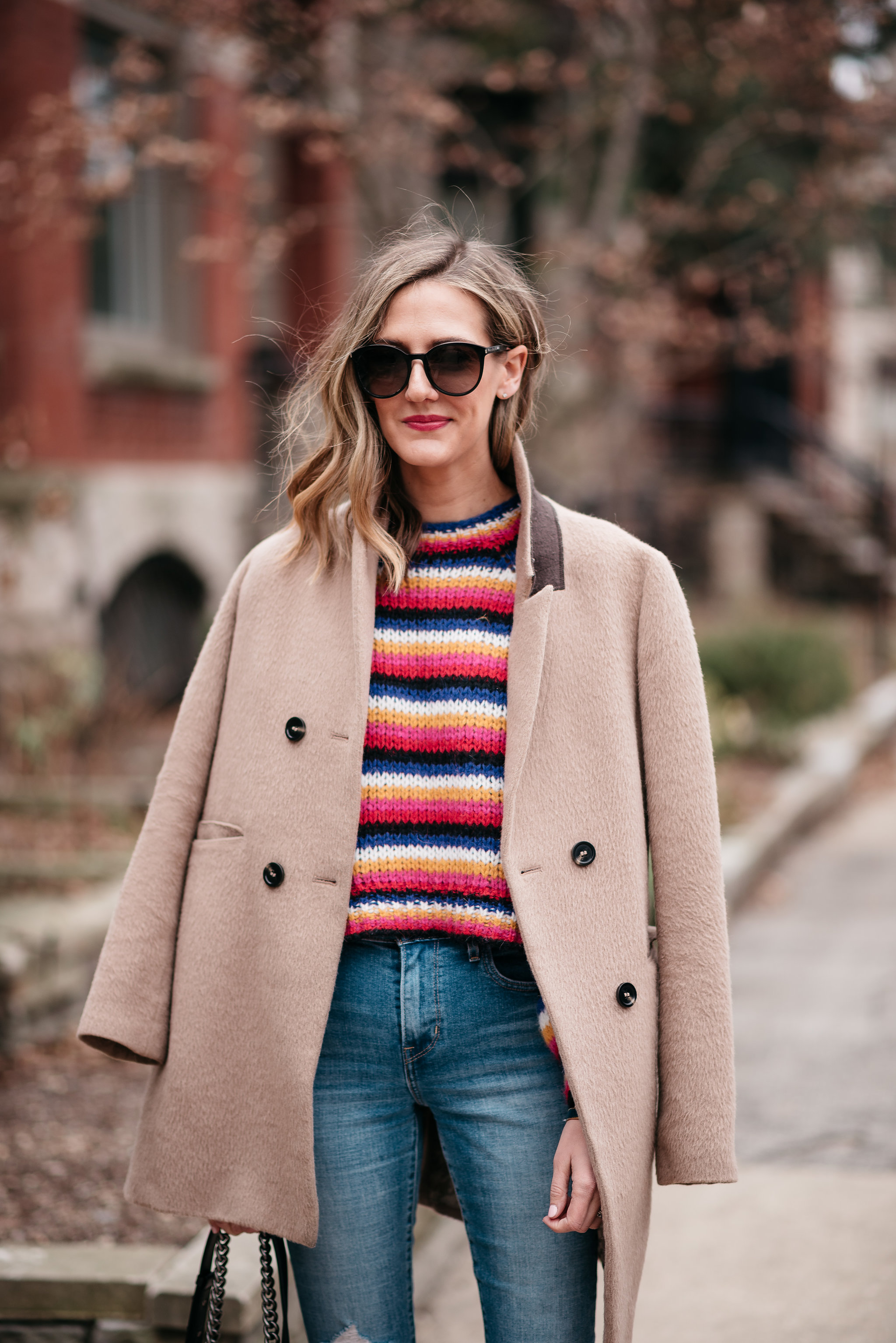 how to wear a colorful striped sweater