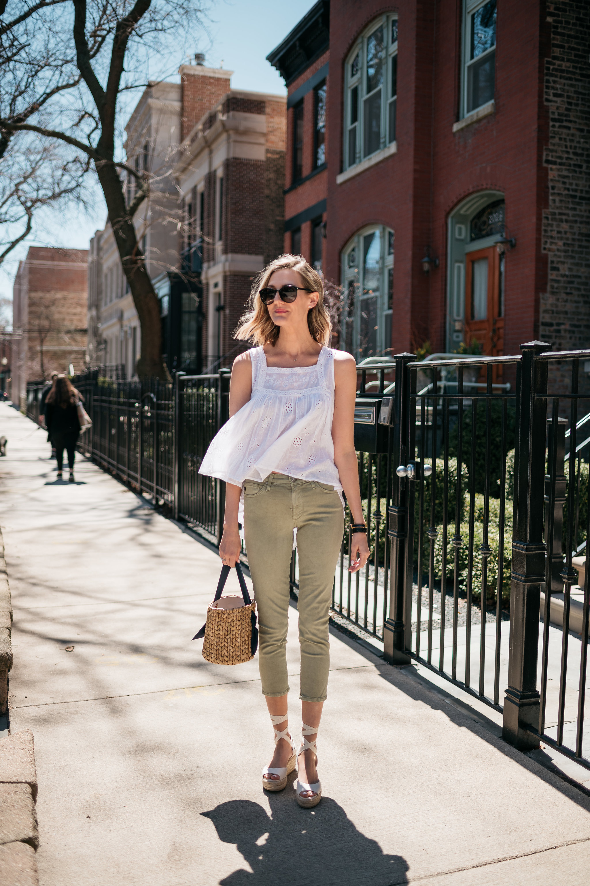 white top and army green pants