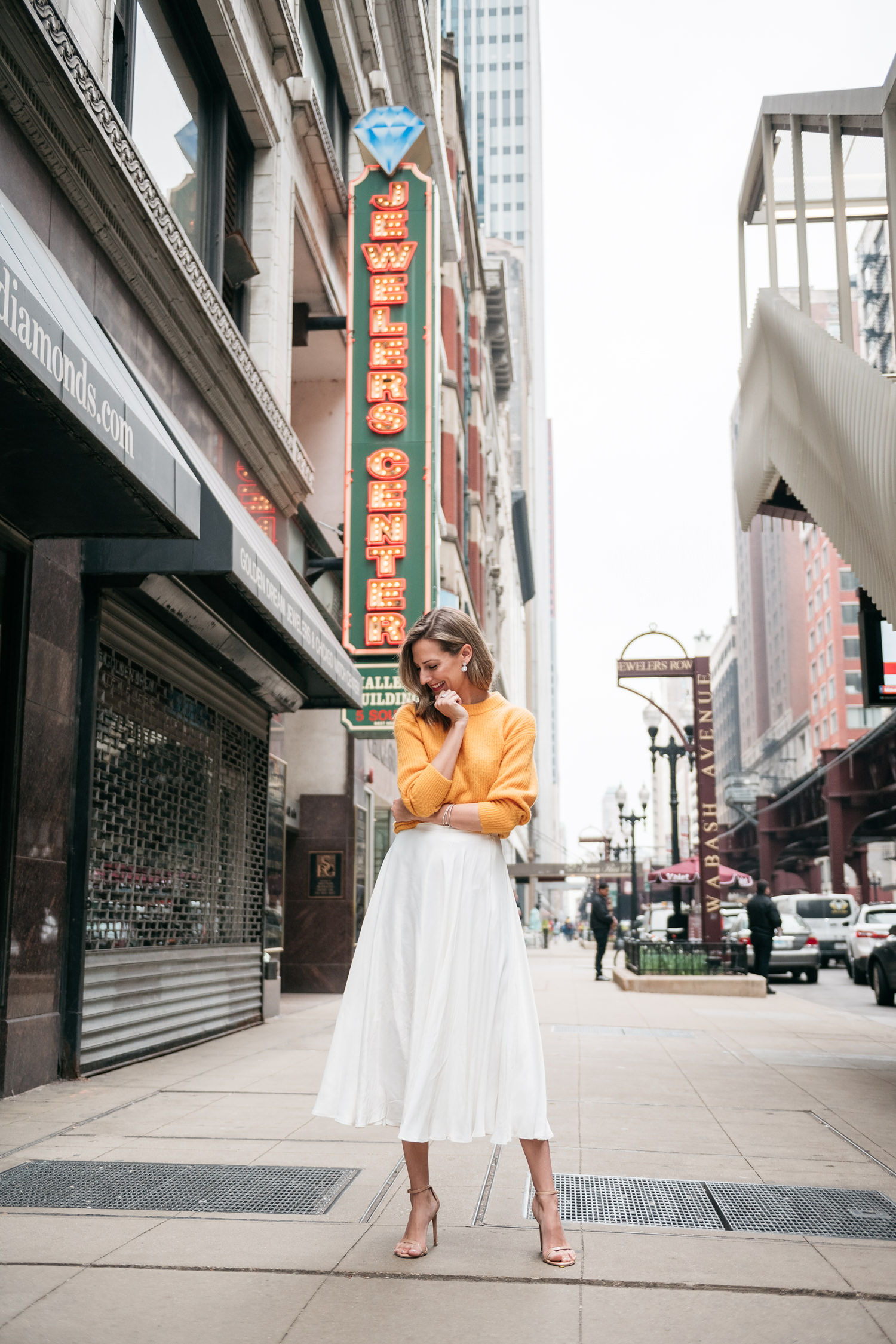 white midi skirt and yellow sweater for spring