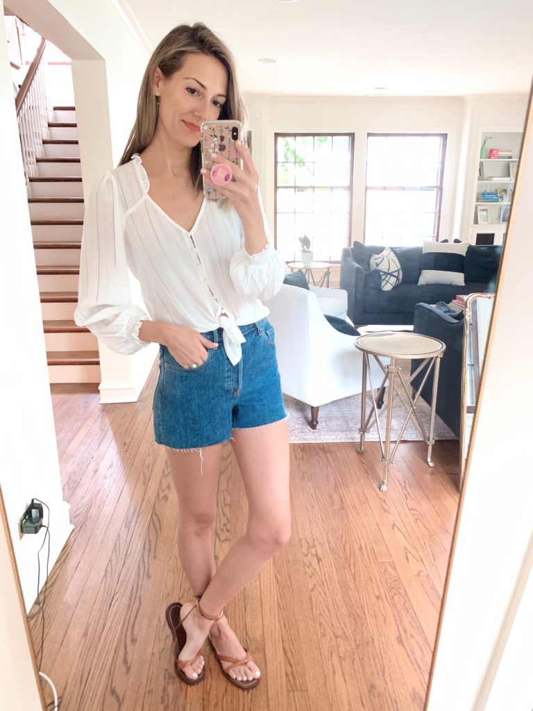 jean shorts and a silk top sandals