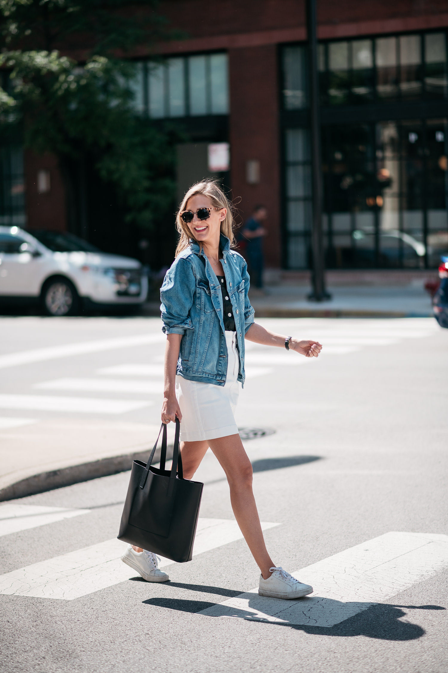 white skirt with jean jacket sneakers