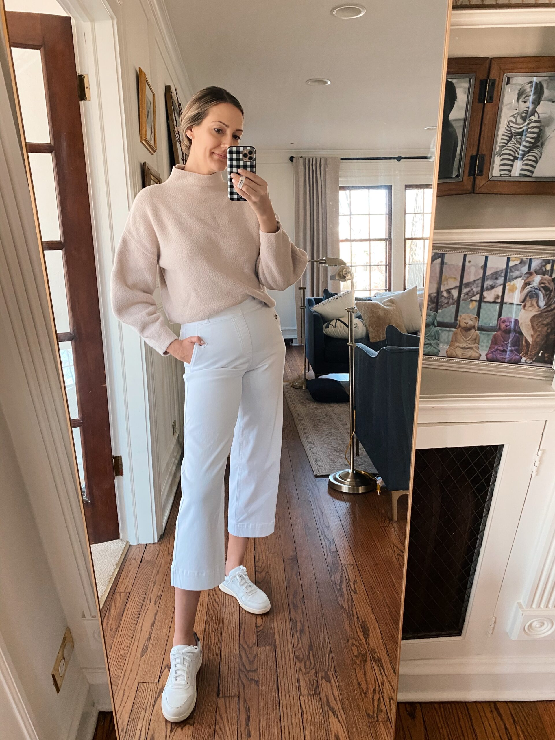 woman wearing white pants, nude sweater, and sneakers for Real Outfit Recap