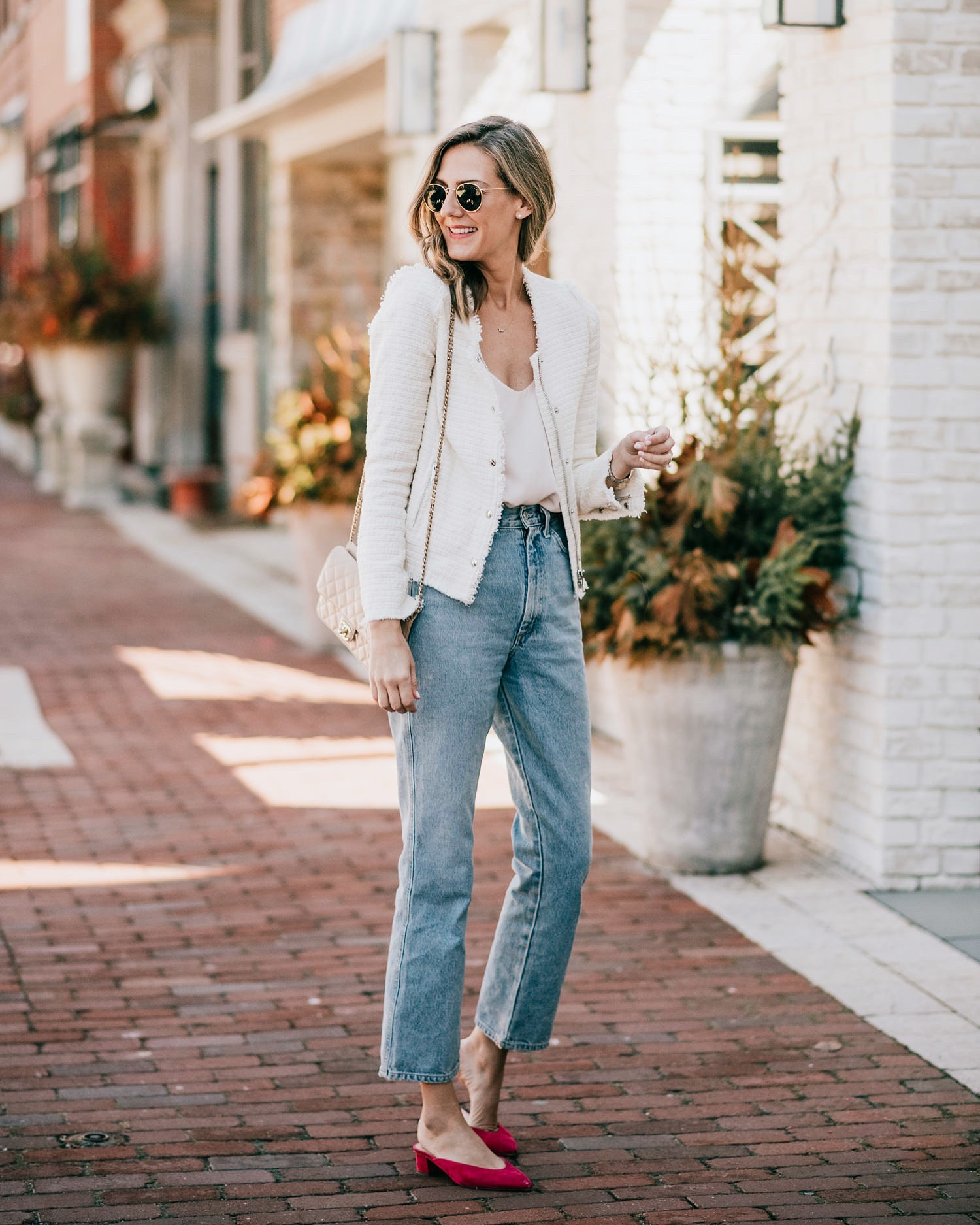 woman wearing white top and jeans for Denim to Love