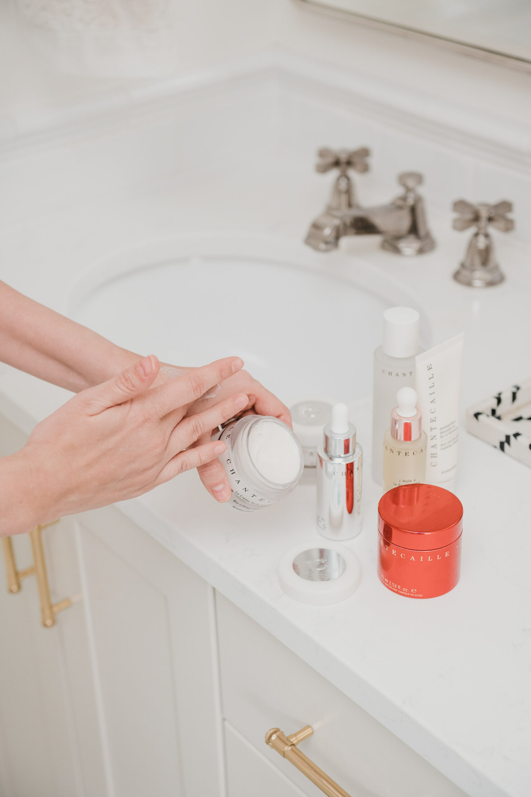 woman applying product on her hand for Chantecaille Skincare Review