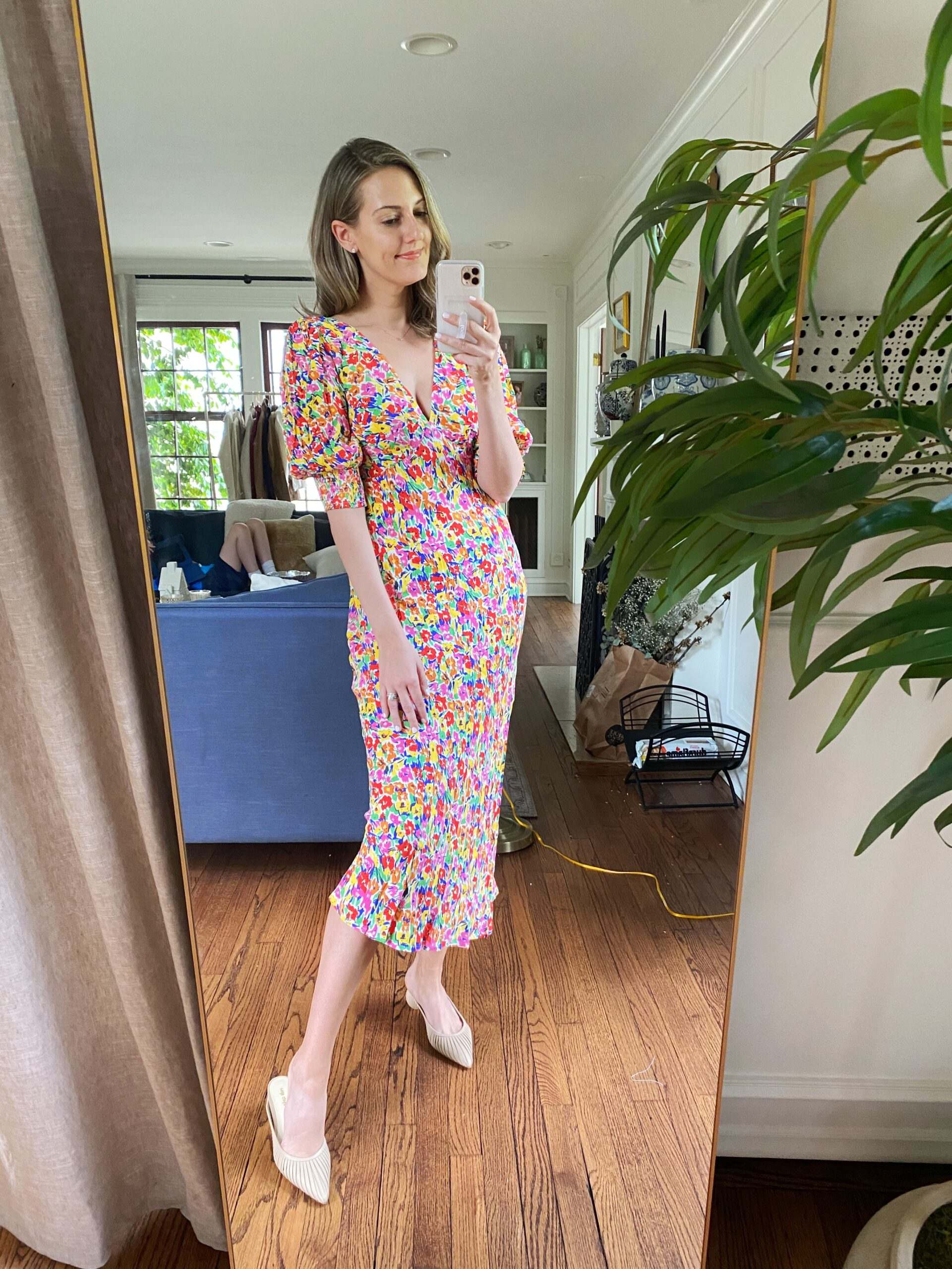 woman wearing floral midi dress