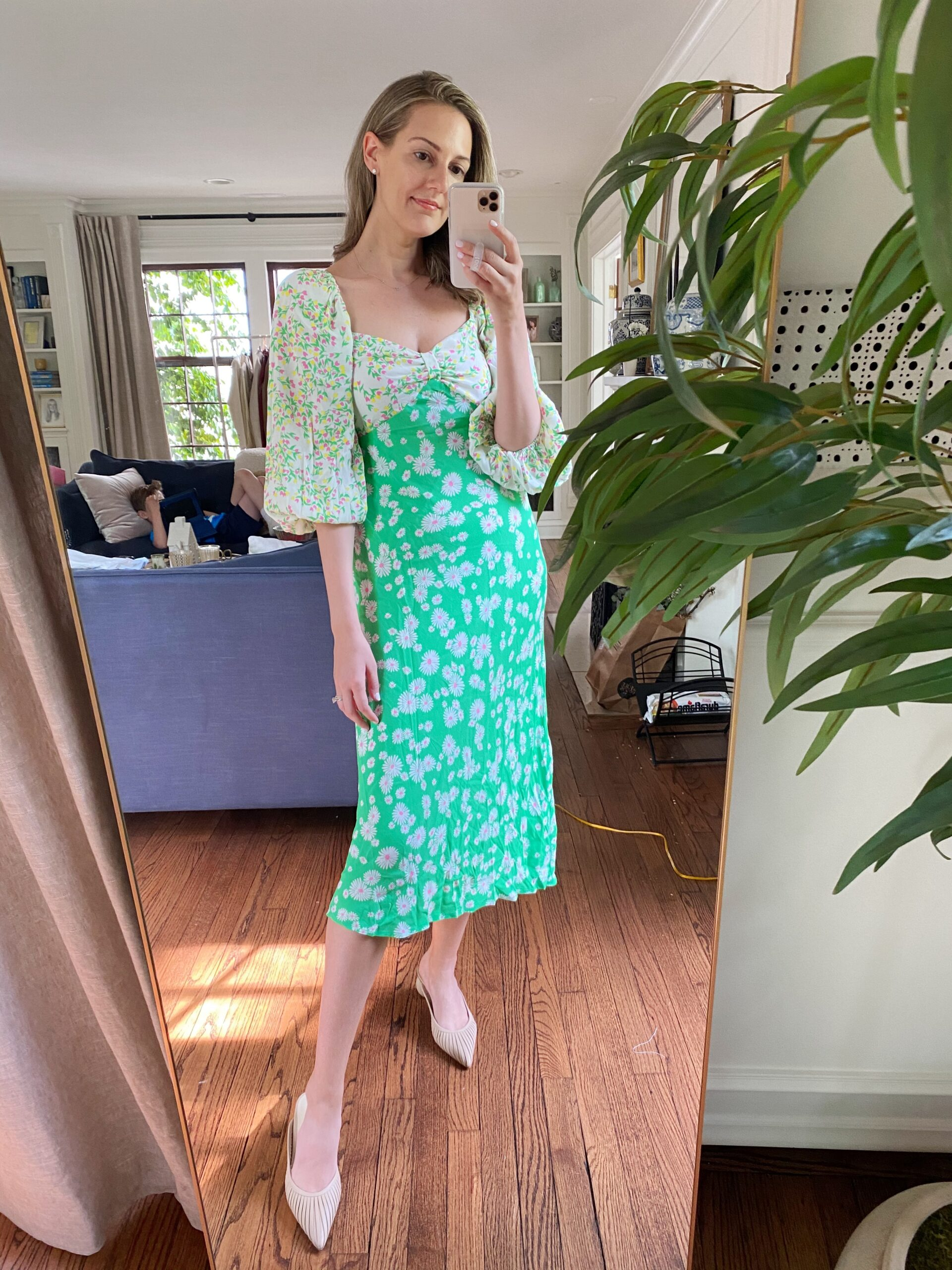 woman taking a selfie wearing mint floral dress for Target Rixo Dress