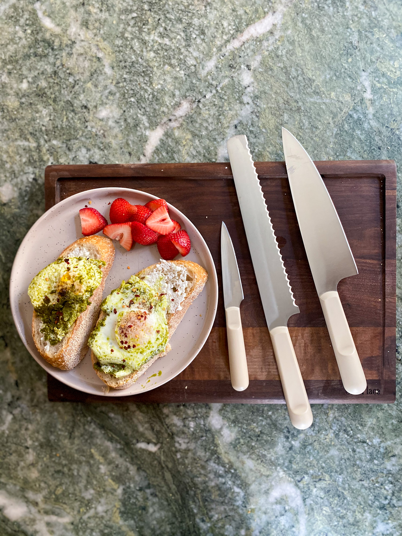 Our Place Knives Review on a chopping board and plate with food