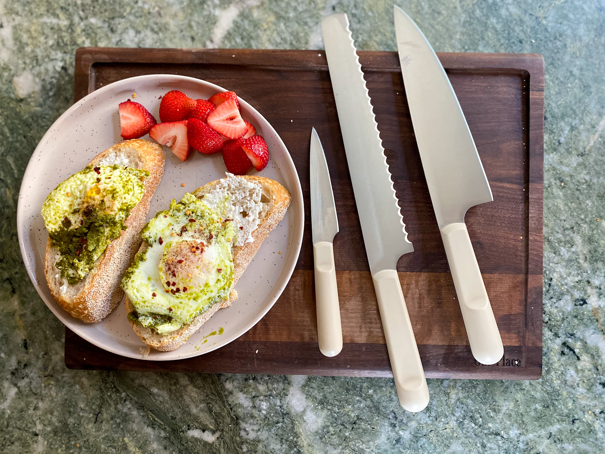 Our Place Knives Review knives on a chopping board and plate with food