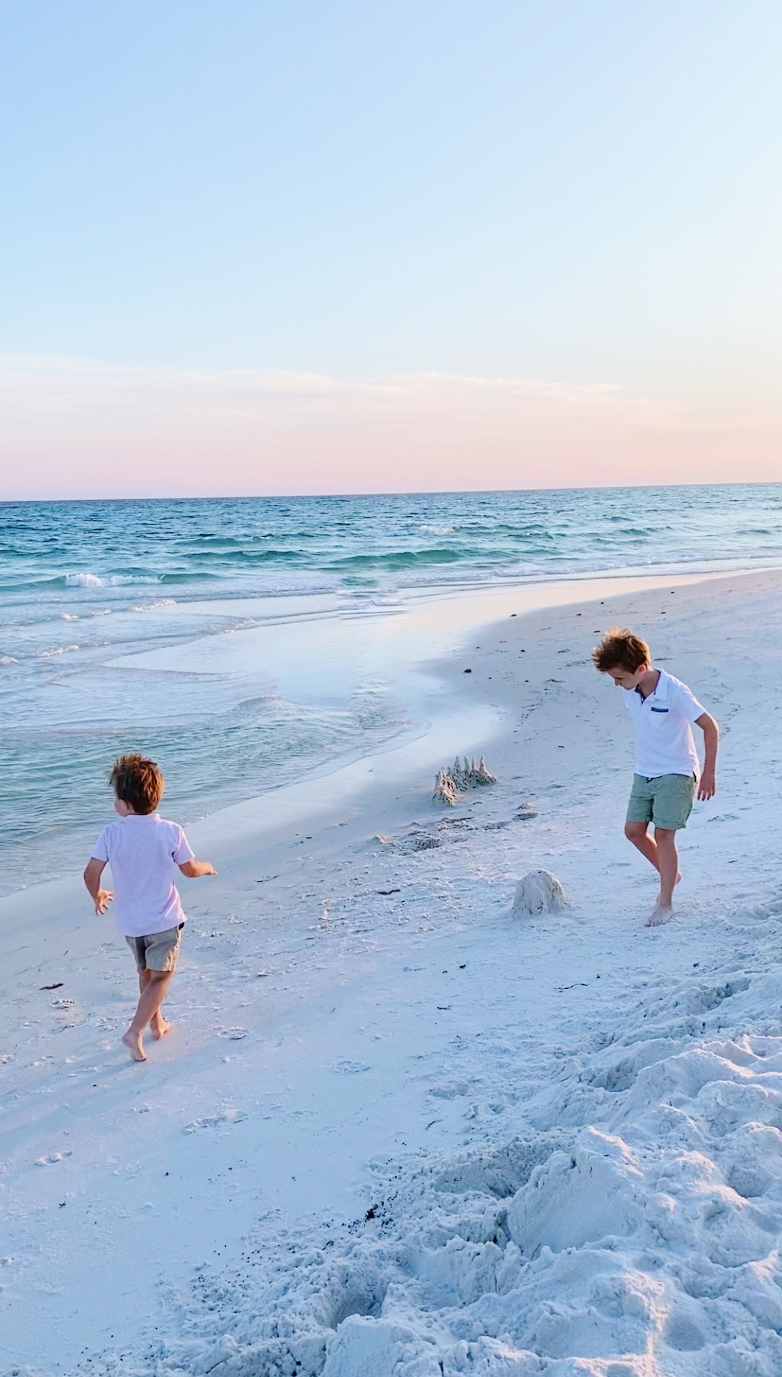 two kids playing at the shore sharing Why I'm Renewing Walmart+