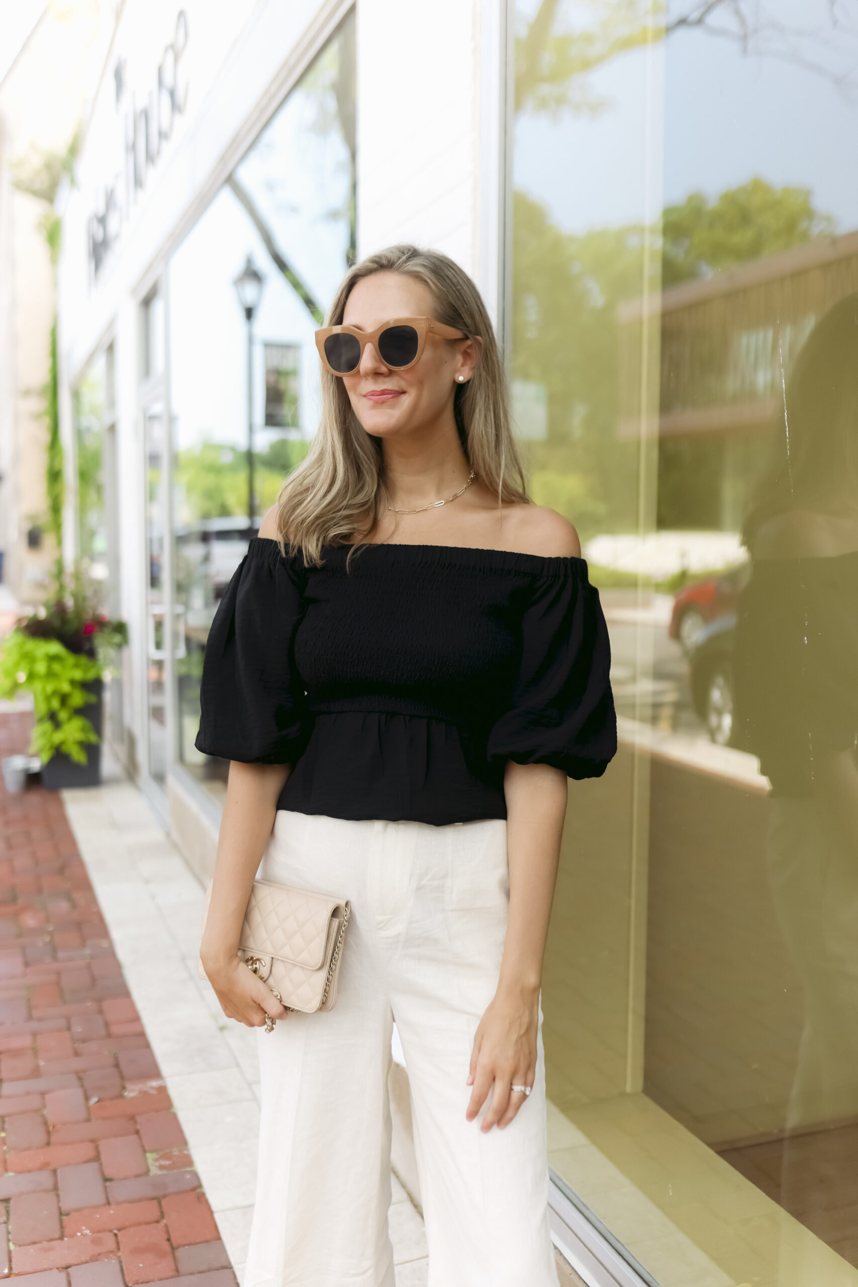 woman wearing black top and white pants from New Styles from Nordstrom Made
